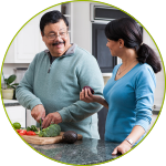 Man and woman preparing a healthy meal and controlling portions